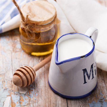Honey with milk in the jug.selective focus