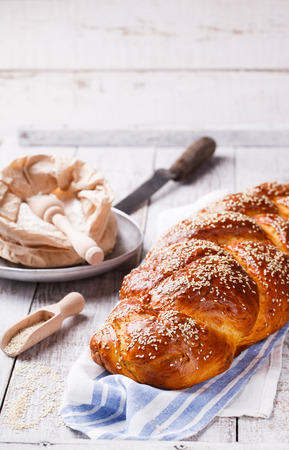 Challah bread with sesame seeds. Pastry,flour and sesame seeds.selective focus Imagens