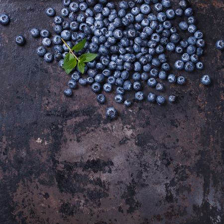 Blueberries on a dark background.Copy space for your text. Healthy food.selective focus Imagens