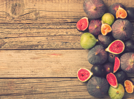 exotic food: Fresh figs in different grade, vintage wooden Board.Copy space.Toned image. Vintage style.selective focus Stock Photo