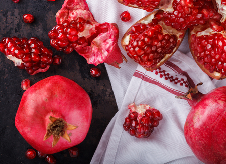 pomegranate: Juicy pomegranates,whole and broken on a dark background.selective focus.