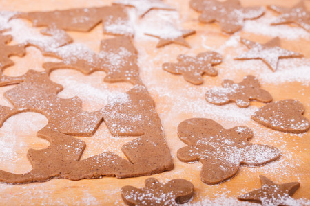 christmas baking: Making gingerbread cookies. Christmas baking background dough . Stock Photo