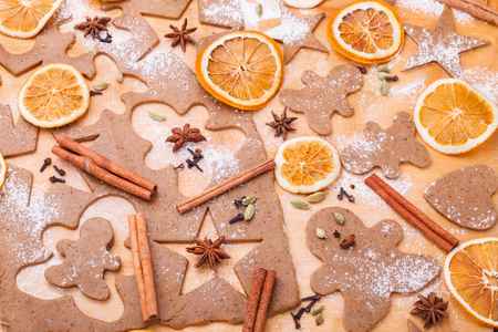 pastry cutter: Making gingerbread cookies. Christmas baking background dough . Stock Photo