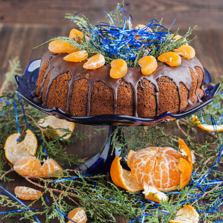 Cake with mandarins for Christmas.selective focus Imagens