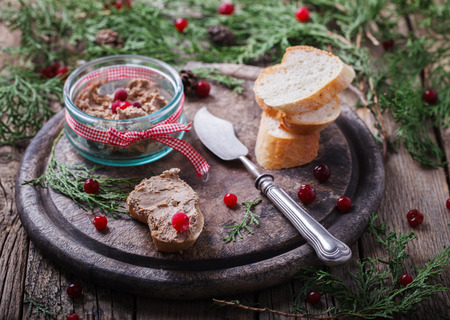 snack food: Liver pate with cranberries .Appetizer for Christmas.selective focus.