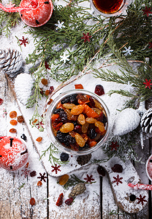 candied fruits: Dried fruits and candied fruits soaked in the rum for baking fruit cake stylenow. Christmas gift.selective focus.