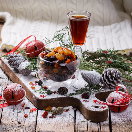 Dried fruits and candied fruits soaked in the rum for baking fruit cake stylenow. Christmas gift.selective focus.