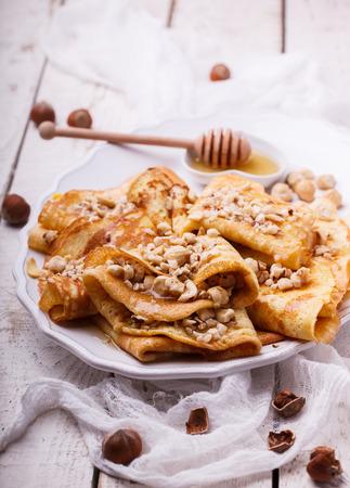 pancake week: Pancakes with nuts and honey, traditional for Russian pancake week.