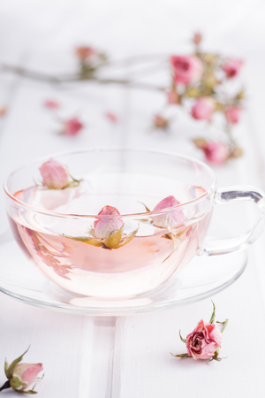 Tea with rose petals in a glass Cup. Rose water.