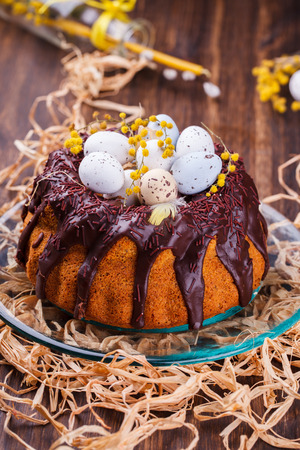 chocolate dessert: Easter cake with chocolate decorated with colored quail eggs and Mimosa.selective focus.