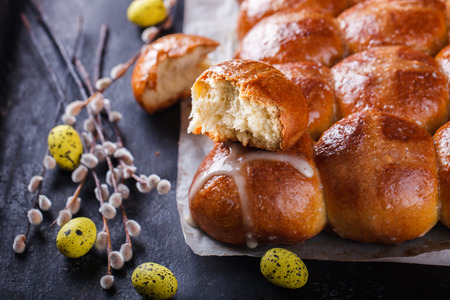 Easter Hot Cross Buns on a dark background.