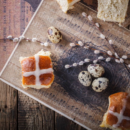easter cross: Easter Hot Cross Buns on wooden background.