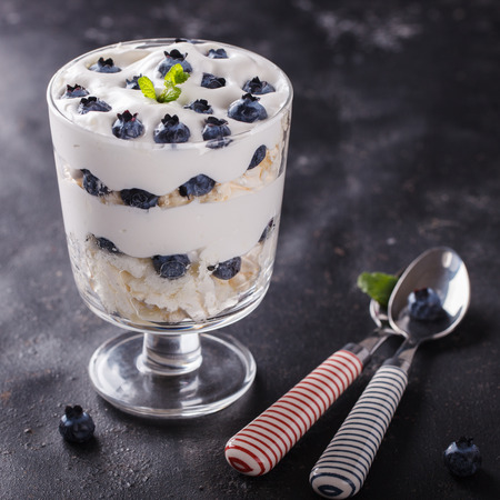 eton mess: Eton mess - Blueberry with whipped cream and meringue is a Classic British summer dessert in a glass.selective focus