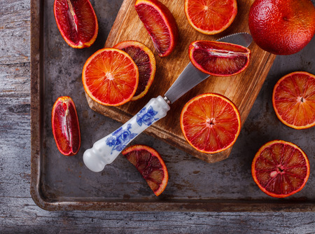 blood orange on a wooden Board,cut into wedges.selective focus.