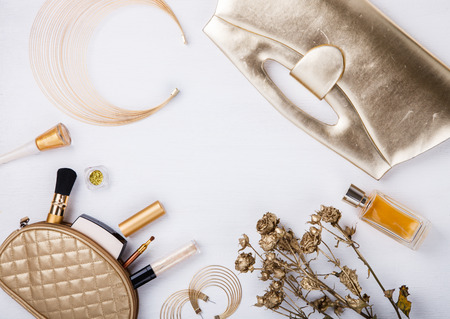cosmetics bag: Still life of fashion woman. Feminine cosmetic background.Womens set of fashion accessories in golden color.Copy space.selective focus. Stock Photo