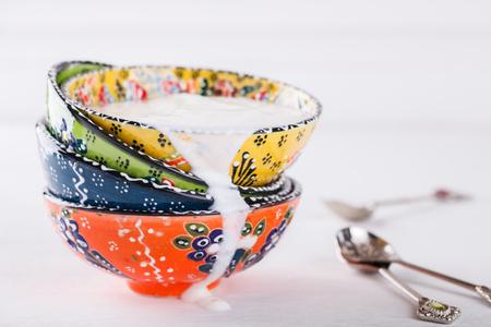 lactic: Yogurt,ayran homemade, traditional Turkish ceramic dishes.selective focus.