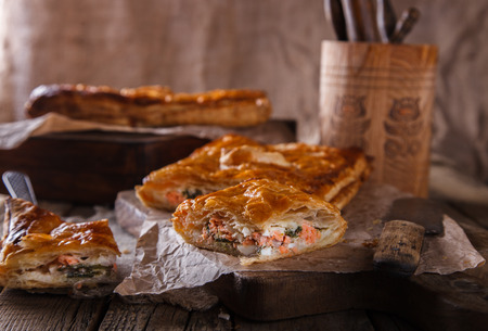 stuffing: Puff pastry with savory stuffing salmon and spinach. selective focus.