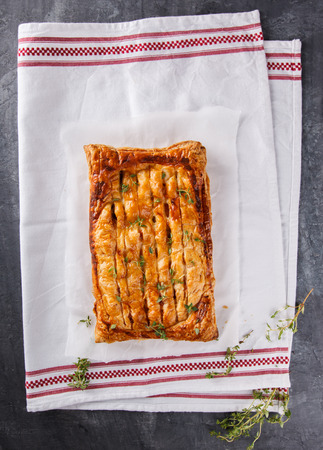 savory: Puff pastry with savory stuffing and thyme. selective focus. Stock Photo