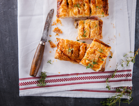 stuffing: Puff pastry with savory stuffing and thyme. selective focus. Stock Photo