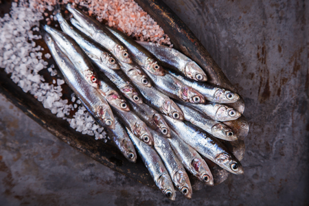 crowd tail: Anchovy Fresh Marine Fish.Appetizer. selective focus. Stock Photo