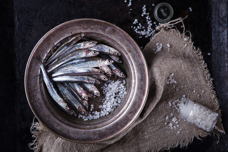 Anchovy Fresh Marine Fish.Appetizer. selective focus. Stock Photo