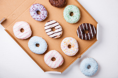 Donuts in colored glazes on a white background.Pastries,dessert.selective focus.