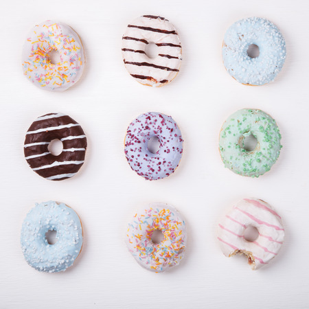 glazes: Donuts in colored glazes on a white background.Pastries,dessert.selective focus.
