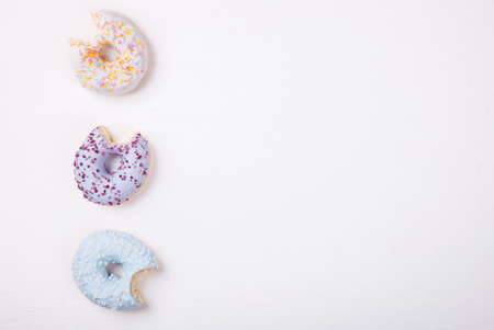 glazes: Donuts in colored glazes on a white background.Pastries,dessert.Copy space.selective focus.