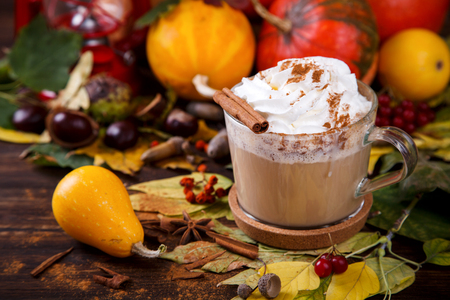 Pumpkin Smoothies, Spicy Drink is a cinnamon Latte, whipped cream. Autumn still life. selective focus. Stock Photo