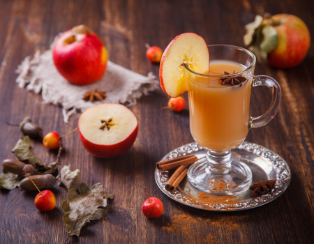 Apple cider drink, Cider with Spices, cinnamon sticks and fresh apples. Hot drink for Autumn and Winter evenings. selective focus.
