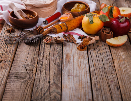 Baking Background. Ingredients  for baking Apple Pie  - apples, spices, flour,  rolling pin, eggs, egg yolks, butter served.Vintage style.selective focus. Copy space.