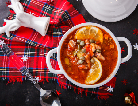 Christmas soup, Solyanka. Festive table.