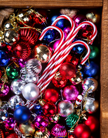 Christmas Toys,Colored Balls in a Wooden box on a Black Background.  top view. Copy space. selective focus.New Year Christmas card.