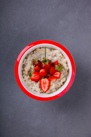 Oatmeal Porridge with fresh Berries,Strawberry.Breakfast.Concept of Healthy Eating. Copy space.selective focus.