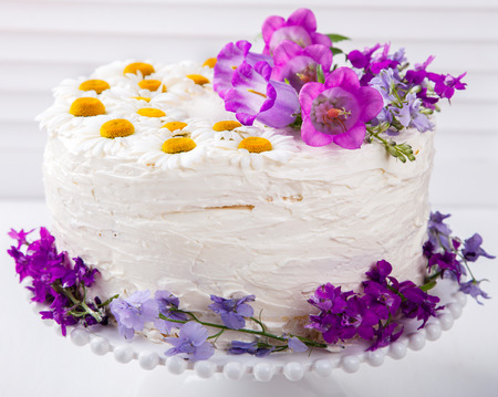 Cake Festive  with Cream decorated with fresh Flowers.selective focus.