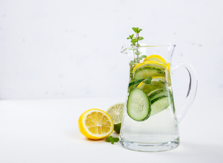 Detox Infused Water with Lemon, Lime,Cucumber and Mint  in the jar Glass  on a White Background.Healthy Beverage.Food  diet concept.Vegetarian.Copy space for Text. selective focus.