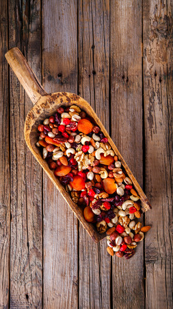 nutshells: Nuts and dried fruit mix . Concept of Healthy Food. Vintage wooden background. Copy space for Text. selective focus