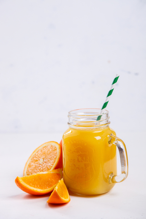 Juice Fresh Orange on a White Background.Healthy Beverage.Food or Healthy diet concept.Copy space for Text. selective focus