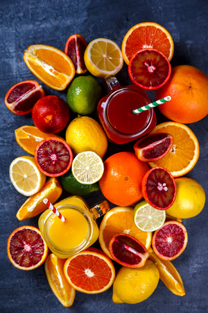 Juices Fresh Orange and Citrus.Healthy Beverage.Food or Healthy diet concept.Mixed Colorful Tropical Background.Copy space for Text. selective focus Stock Photo