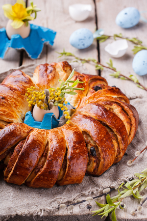 Easter bread with egg decoration and flowers.selective focus
