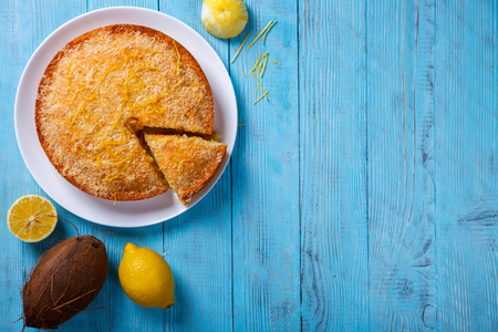 pound cake: Cake with Lemon and Coconut.Homemade Cakes on a Blue Background.Copy space for Text. selective focus.