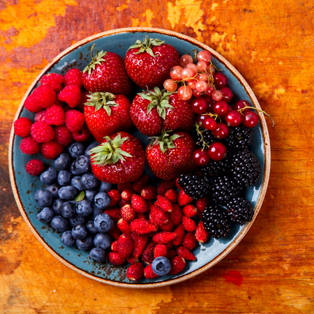 Various Fresh Summer Berries. Food or Healthy diet concept.