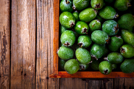subtropical: Feijoa Fruits. Fresh ripe sweet .Tropical fruit. Background of green color.Food or Healthy diet concept.Super Food.Vegetarian.Top View.Copy space for Text.selective focus.