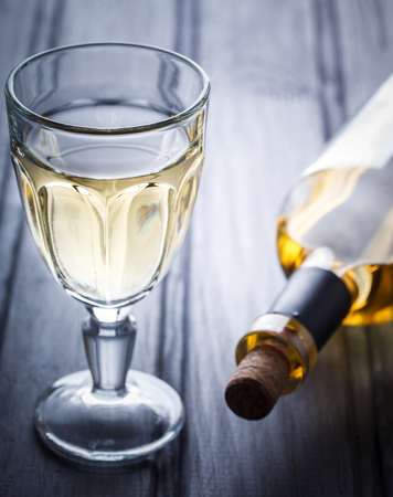 Glass of white Wine. Alcoholic Drink from Grape.Toned image.Vintage style.selective focus. Stock Photo