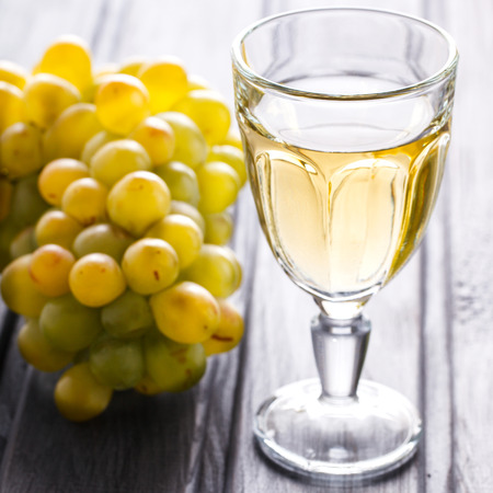 Glass of white Wine. Alcoholic Drink from Grape.selective focus.