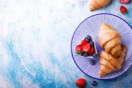 Breakfast Continental  with Fresh  Croissants and ripe Berries .Delicious Baking with Berry Jam  Top View Copy space for Text Reklamní fotografie
