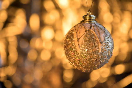 Defocused Abstract Blurred Shiny Christmas Background with Sparkles Golden Ball   Decoration Happy New Year  Festive Holiday  with Light Effect Boke Space for text Selective focus