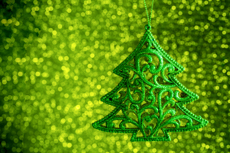 Defocused Abstract Blurred Shiny Christmas Green Background with Sparkles    Decoration Spruce Happy New Year  Festive Holiday  with Light Effect Boke Space for text Selective focus 免版税图像