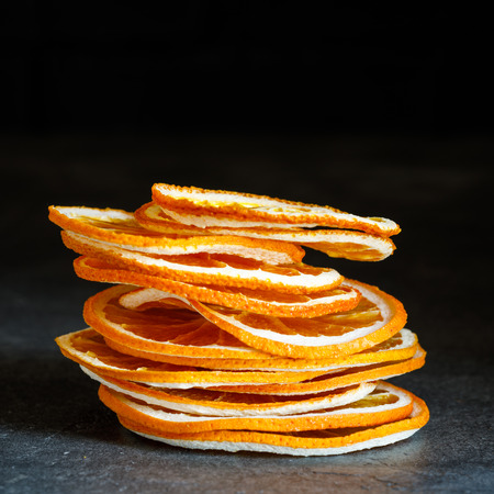 Natural Oranges Dried Sliced Candied Fruits Citrus Caramelized on the dark Background Food