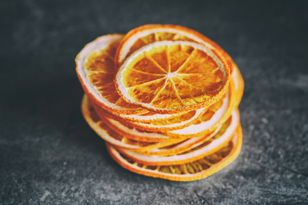 Natural Oranges Dried Sliced Candied Fruits Citrus Caramelized on the dark Background Food  Toned image Vintage style